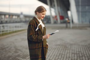 young woman with traveling documents